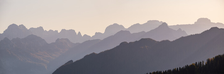 Wall Mural - Evening Dolomite mountain tops silhouettes peaceful view from Giau Pass, Italy. Climate, environment and travel concept scene.