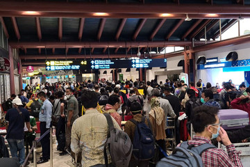 A crowd of people with luggage stand in line at Soekarno-Hatta International Airport, during the outbreak of the coronavirus disease (COVID-19)