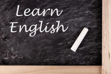 Learn English text written On Blackboard, education concept