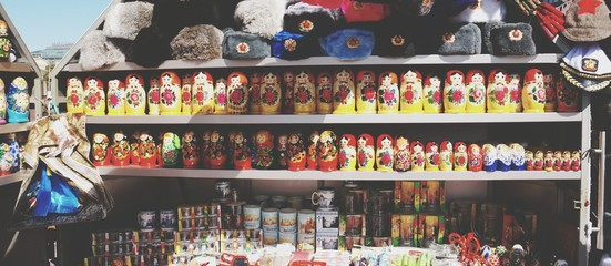Souvenirs Arranged On Shelf In Shop