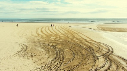 View Of Tire Marks On Beach
