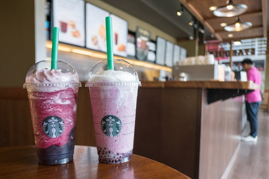 Chiang Rai, Thailand : 20 August 2018 : Couple cup of Venti Starbucks frappuccino new menu Ruby red grape and Acai mixed berry yogurt in Starbucks coffee shop.