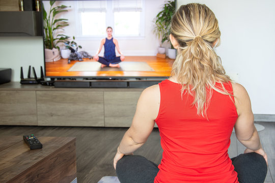 Yoga at home online, in front of the TV