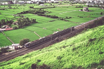 Fototapeten Grau High Angle View Of Train Along Countryside Landscape