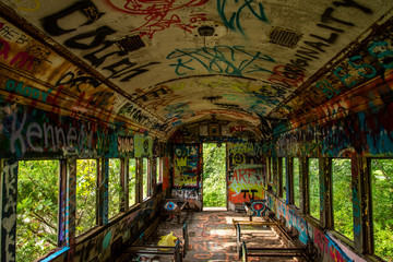 An abandoned train with graffiti