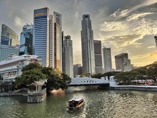 Ferryboat In River Against Tall Buildings Fotobehang