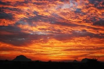 Foto auf Gartenposter Ziegel Silhouette Landscape Against Dramatic Sky At Sunset