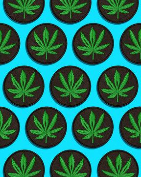 Cannabis Leaf Black Patch in Grid Pattern on Blue Background
