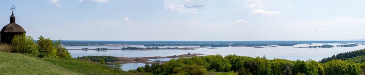 Garden Poster Cyprus Panorama of Dnieper with old wood church in Vytachiv, Ukraine on May 3, 2020.