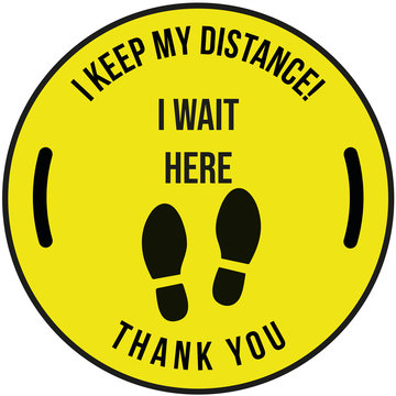 Sign on the measure thank you I keep my distance and I wait here written in black in a yellow circle