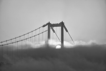Foggy and Misty scene of Bosphorus Bridge. Bridge over the Bosphorus in Istanbul. View from the Asian part of Istanbul. The 15 July Martyrs Bridge in a fog