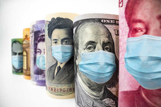 International currency money include US American Dollar, Euro Currency, British UK Pound, Australian Dollar, China Yuan and Japan Yen face mask concept of coronavirus disease COVID-19 economic crisis.