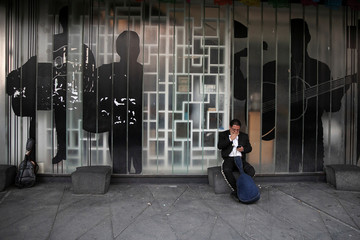 A mariachi waits for customers at Plaza Garibaldi as he and others take part in a protest to be allowed to perform at the location and get access to government financial aid due to the ongoing outbreak of the coronavirus disease (COVID-19), in Mexico City