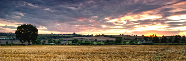 Panoramic Shot Of Agricultural Field Against Cloudy Sky During Sunset Fototapete