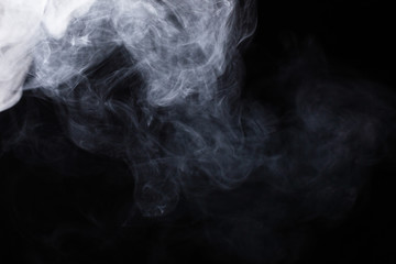 White steam on a black background. Wall mural