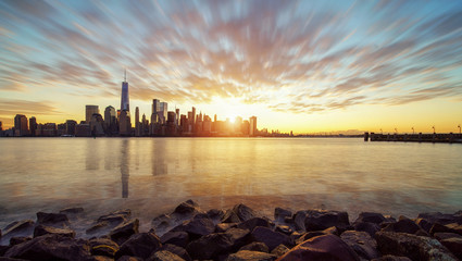 Fototapete - New York City skyline with urban skyscrapers at sunset