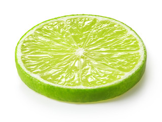 Wall Mural - slice of green lime isolated on white background