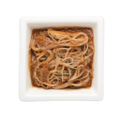 Asian cuisine - Rice vermicelli with peanut sauce in a square bowl isolated on white background;
