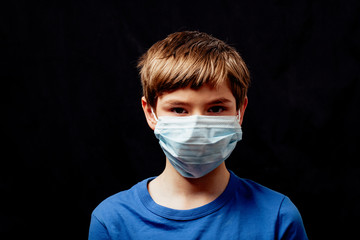 Caucasian boy with surgical face mask