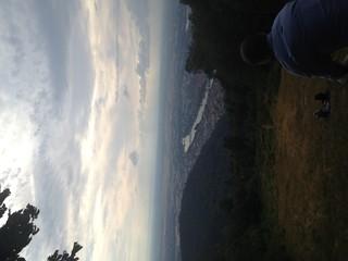 Foto auf AluDibond Rosa dunkel Man Overlooking Countryside Landscape
