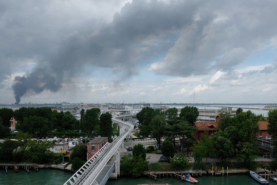 Large clouds of black smoke billows from chemical plant in Marghera near Venice after an explosion