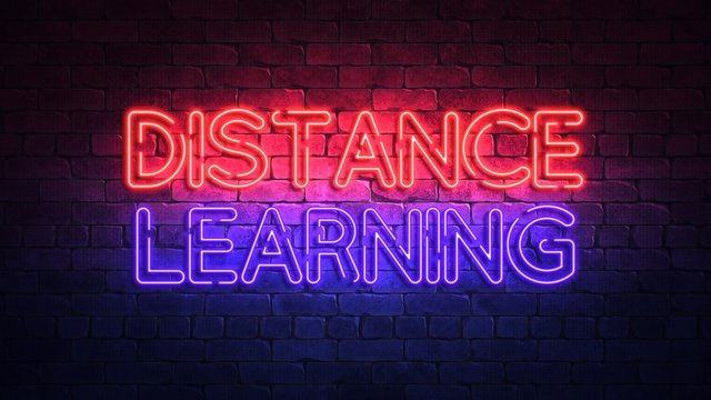 Glowing neon sign with the words DISTANCE LEARNING. purple and red glow and brick wall on the background 3d render