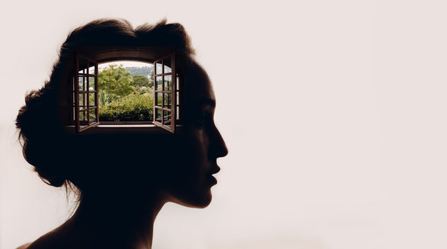 Beautiful woman with opened window with garden in her head.