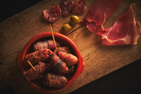 Bacon wrapped dates in a tapas bowl. Spanish Tapas, Spanish Food.