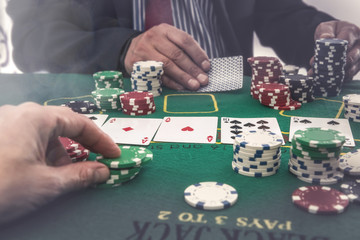 Two players playing poker or blackjack in casino