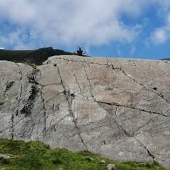 rock climber on top of rock