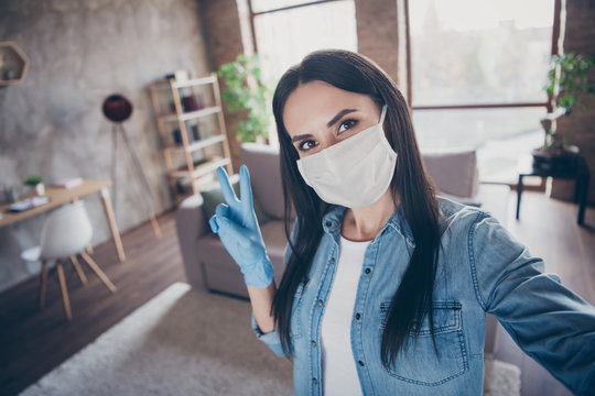 Self-portrait of her she nice attractive lovely brunette girl wearing mask gloves sanitary measures showing v-sign leisure free time healthcare in modern loft brick industrial house apartment
