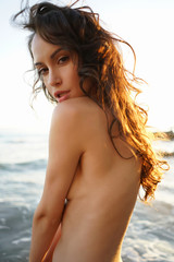 Stores photo womenART Beautiful brunette woman on the beach