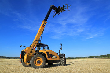Cat TH407C Telescopic Handler on Stubble Field. Illustrative Editorial Content.