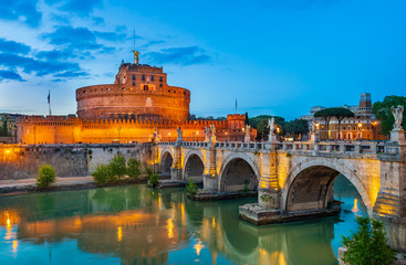 Night view of Castle Sant Angelo (Mausoleum of Hadrian), bridge Sant Angelo and river Tiber in Roma. Italy.