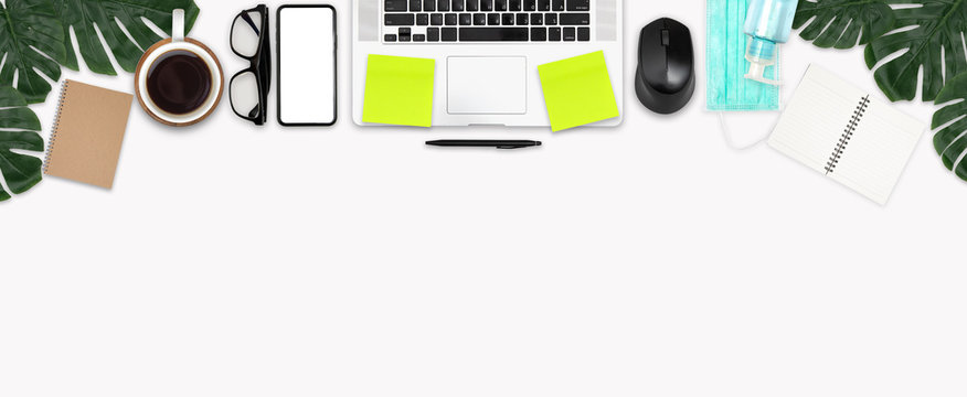 Work space office desk table top header at home wide layout upper have laptop, mock up phone isolated, mask, alcohol gel, glasses, book work from home virus covid-19 scourge stay at home