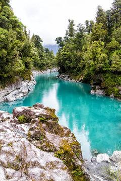 Blue water of the Hokitika River through the rock sided at Hokitika Gorge Scenic Reserve, West coast, south island New Zealand