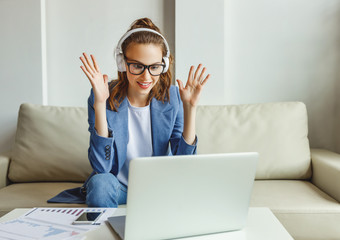 Excited busy woman talking with colleague in video chat.