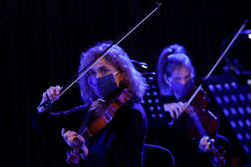Musicians of the Ukrainian Radio Symphony Orchestra take part in a rehearsal after an easing of lockdown measures in Kiev