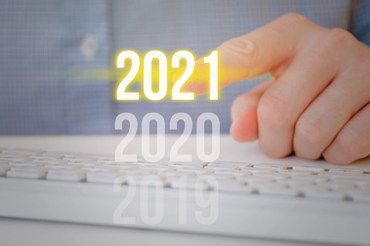 The year 2021 is pointed by a man.
