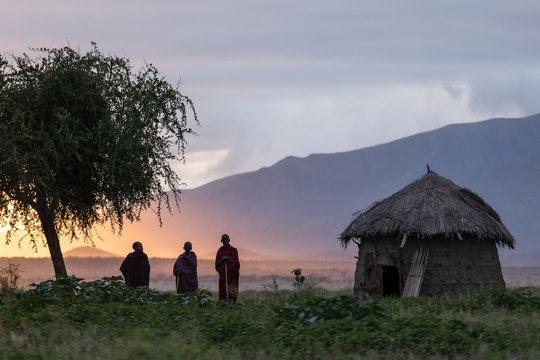Arusha, Tanzania on 1st June 2019. Group of masai people at there village during the sunrise with beautiful colourful background