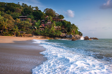 incredible beauty and paradise Haad Than Sadet Beach with azure sea and golden sand on the island of Ko Pha-ngan in Thailand with a fabulous hill village