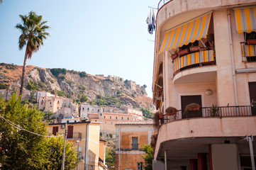 Old streets of Amantea city in Italy, Calabria. Castello di Amantea on rocky mountains. Sunny summer day