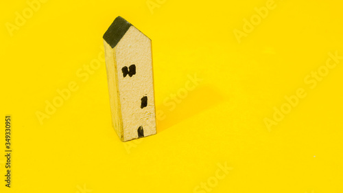 Wall mural Home on yellow background  minimalistic concept