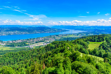 Panoramic view of Zurich lake and Alps from the top of Uetliberg mountain, from the observation platform on tower on Mt. Uetliberg, Switzerland, Europe