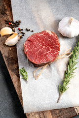 Printed roller blinds Steakhouse Raw beef filet Mignon steak on a wooden Board on paper with ingredients for grilling