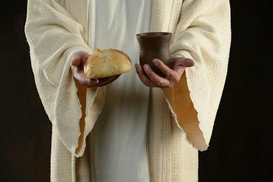 Jesus holding the bread and the wine