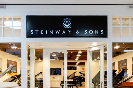 Orlando, Florida, USA- January 14, 2020: Steinway & Sons sign outside of the store in Orlando, Florida, USA; Steinway & Sons, also known as Steinway is an American piano company.