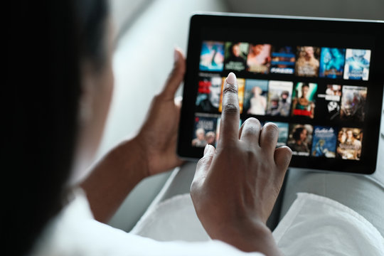 Black Woman Browsing Movie On Streaming Media Service
