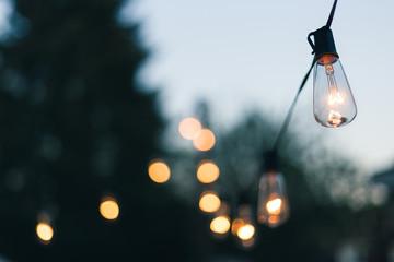Close-up Of Illuminated Light Bulb Against Sky