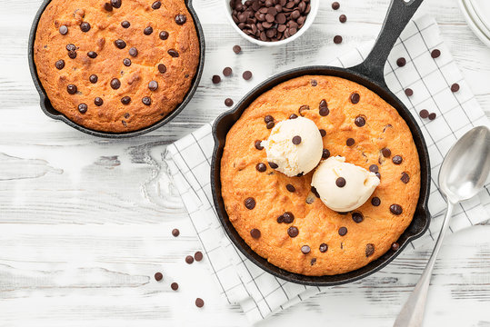Giant skillet cookie with chocolate chips served with ice cream.